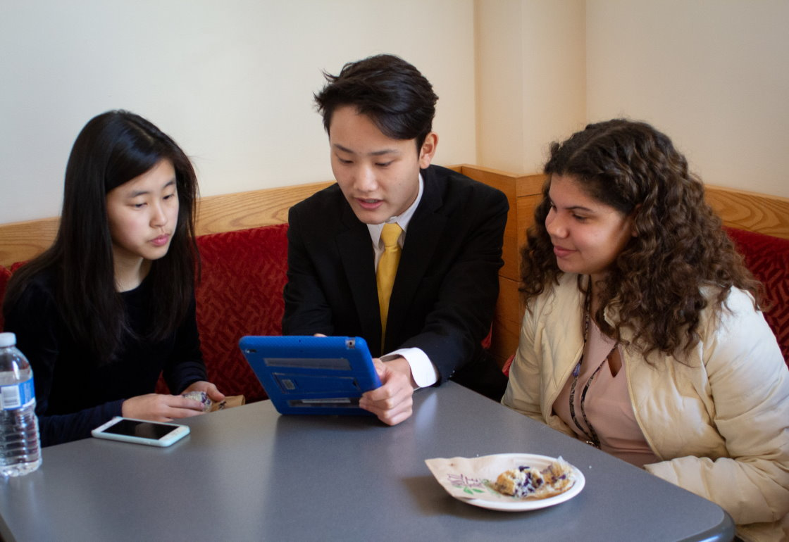 A group of students using ipad